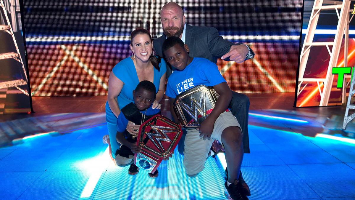 Jarrius Robertson with Stephanie Mc Mahon and Triple H
